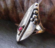 Hey, I found this really awesome Etsy listing at https://www.etsy.com/listing/262214744/silver-leaf-textured-garnet-ring