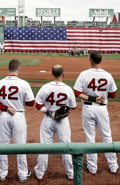 Boston Red Sox players line up for the National Anthem all wearing number 42 in honor of Jackie Robinson Day before a baseball game between the Red Sox and the Tampa Bay Rays at Fenway Park in Boston Monday, April 15, 2013. (AP Photo/Winslow Townson)
