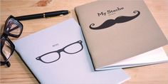 notebook glasses and moustache