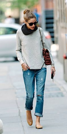 Olivia Palermo in a sweater, infinity scarf, boyfriend jeans and nude flats.
