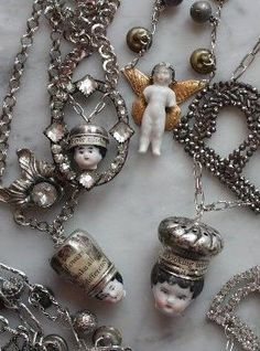 ooak wearable art by Dara DiMagno. cute ideas to use up my stash of charlotte dolls Jewelry Crafts, Jewelry Art, Vintage Jewelry, Handmade Jewelry, Jewelry Design, Jewellery, I Love Jewelry, Jewelry Making, Found Object Jewelry