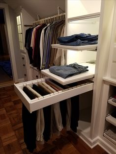Custom Walk-in Closet, slanted ceilings...full extension pull-out pants rack.