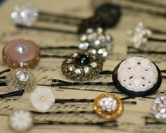 bobby pins with vintage buttons...or maybe even broken earrings, etc. I could make a ton of these with my mom's jewelry.