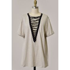 Lace Up Tee New with tag Available in sizes S, M, L Folded short sleeve tunic top with shoe lace detail V-neck line 100% cotton Feel free to ask me any questions Thanks for browsing my closet! Happy Poshing Tops Tees - Short Sleeve