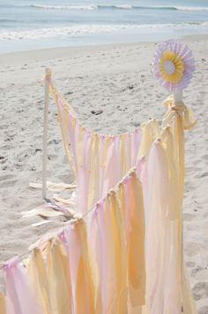 This beautiful ribbon garland is the perfect way to designate your outdoor party space. #birthdayparty
