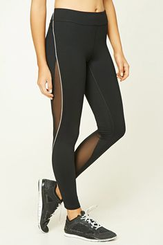 An athletic pair of knit leggings featuring mesh paneling, mesh cutouts at the side, reflective strips along the sides, a hidden key pocket, and moisture management.
