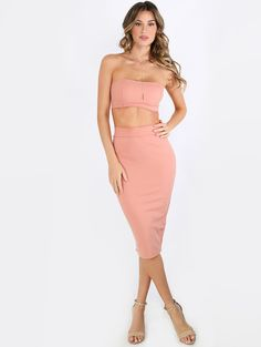 """Feminine meets sexy in the Bandeau Matching Set! Features a crop tube top and a midi bodycon matching midi skirt. Top measures 6"""" approx. from top to bottom hem. Skirt measures 26.5"""" approx from waist to bottom hem. Pair with single sole heels and a faux suede choker!"""
