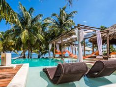 A small private seaside resort with a striking central pavilion and 13 villas on a well-kept, mellow beach far from the increasingly madding scene of San Pedro. Tropical woods, thatch, and stone mosaics offset by vivid orange umbrellas and hammocks and the blues of pool and sea.read more