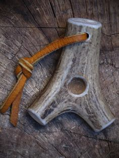 wow! a beautiful hand hold made from antler - it even has a buckskin strap!!