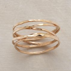 "Five strands of hand hammered 14kt goldfill encircle your finger with infinite style. Each ring is one of a kind. Made in the USA. Whole sizes 5 to 9. 1/4""W."