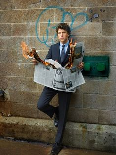 I will never be as cool as Jesse Eisenberg reading a burning newspaper in an alley. I won't even be cool enough to understand what the point of the picture is.
