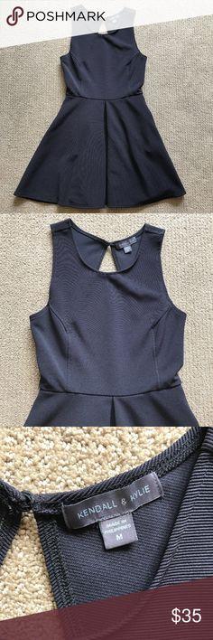 "Kendall & Kylie Blue A-line Dress Sz M Cutout Back Kendall & Kylie Blue A-line Dress Size M Cutout Back I18 chest: 29"" Waist: 25"" length: 32"" 98% polyester 4% spandex Kendall & Kylie Dresses"