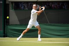 Tuesday 1 July 2014 / Wimbledon 2014 / A backhand slice from Roger Federer - Tom Lovelock/AELTC