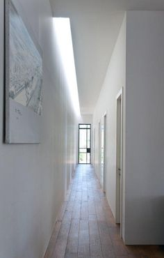 Top lit corridor inside the House W by Sharon Neuman Architects.