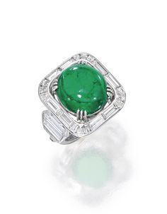 Platinum, Emerald and Diamond Ring, Centered by a cabochon emerald weighing approximately 8.25 carats, framed and flanked by baguette and hexagon-shaped diamonds weighing approximately 3.60 carats | Sotheby's