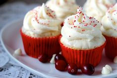 Cranberry White Chocolate Cupcakes topped with White Chocolate Ganache & White Chocolate Buttercream Frosting #cupcakesrecipes http://thecupcakedailyblog.com/cranberry-white-chocolate-cupcakes/