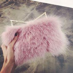 Furry pink clutch