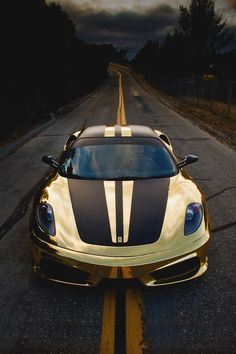 Gold Ferrari 430 Scuderia. Not the best look for a Ferrari, but still...