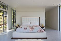 Big, white and bright bedroom with floral bedding