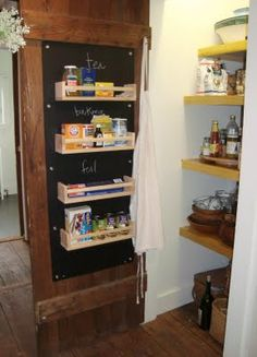 Pantry Closet, I like the shelves on the door, and the white walls with colored shelves.      maya*made: barn kitchen diy part 1