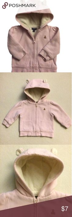 Baby Gap Pink Hoodie Baby Gap pale pink zip hoodie.  Two small pockets in front with adorable bear ears on hood.  Hood is lined with a cream faux fur which Is extremely soft. This hoodie is very warm and would be an essential piece for any babies closet.  Shows some wash wear. Baby Gap Jackets & Coats