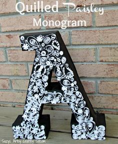 Paper crafts- quilled paisley monogram made from recycled cardboard and card stock.