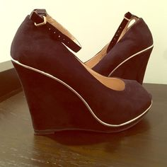 """Black faux suede wedges size 6 Like new condition! Worn only one time! These wedges are a faux suede with gold accent trim and ankle strap, wedge measures at 4"""". Wish I could wear them but now that I'm a mommy I just can't put them to good use. Mossimo Supply Co Shoes Wedges"""