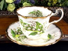 Adderley Heavily Decorated Tea Cup and Saucer, Lily Of The Valley, High Handled Tea CupThis beautiful set is in great vintage condition. There are no chips, cra