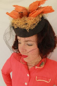 Grey felt tilt hat with double vintage faux birds sitting on a nest composed of brown vintage veiling. A black vintage chin-length veil completes the piece.