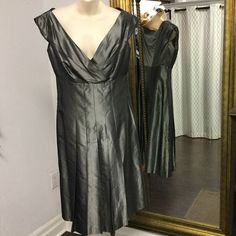Sunny Choi gun metal grey dress. Size 10.  For artist Sunny Choi beauty encompasses a sense of freedom balance and harmony. Her need to create beauty is reflected in her work as a painter and as a fashion designer.  Choi has had an internationally acclaimed career as a designer that blossomed into a 20-year journey establishing her brand in stores such as Saks Fifth Avenue Neiman Marcus Barney's and Nordstrom dressing celebrities such as Alison Krauss Susan Sarandon Daryll Hannah and Sharon…