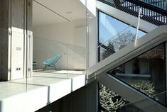 Spectacular Play of Volumes and Materials into Modern Split Level House - InteriorZine
