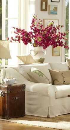 A large floral arrangement can serve as a unique, natural home accessory, like in this living room!