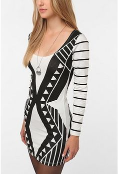 geo dress - urban outfitters... looks really bad on. the screen print gets tiny rips in it, and the back bands stretch the fabric too tight or are baggy if you go a size up. Sucks.