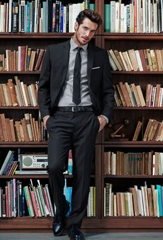 First I noticed the books.  Then I noticed there's a hot guy standing in front of the books.  Priorities.