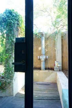 Ha! I love this outdoor shower. Sweet faucet.