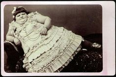 """Blanch Gray, one of many """"Fat Ladies"""" that performed in freak shows. Fat Ladies and Fat Men were often posed nude, in form-fitting bodysuits, or (as above) in odalisque poses. Fatness was sexualized in a way that even race or limblessness wasn't."""