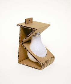 Emballage Michelle Wang, Light Bulb - Sustainable Packaging Design Your One Year-Old's Development T Packaging Carton, Egg Packaging, Cool Packaging, Brand Packaging, Packaging Ideas, Product Packaging Design, Shirt Packaging, Plastic Packaging, Jewelry Packaging