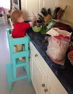 Need one of these! Our Leon been cooking with me since two,  now three be wants to stand on a chair next to me.  This would be so much safer