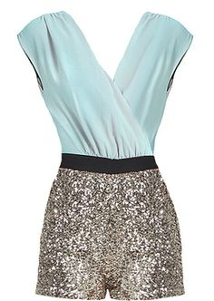 Invite Only Romper: Features a dreamy pastel mint wrapped bodice, slenderizing black waistband, amazing glitzy gold romper shorts, and a hidden side zip closure to finish.