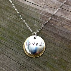 Loved Hand stamped Sterling and Brass Pendant by Bybella on Etsy, $42.00