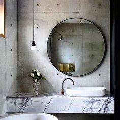 My oh my isn't this beautiful #interiordesign #bathroom #bathroomdesign #architecture #concrete #marble #roundmirror #circle  via Pinterest