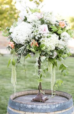 charming wedding centerpiece idea; photo: Jasmine Lee Photography
