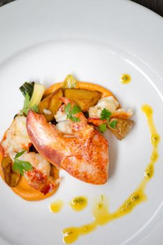 Butter-poached Lobster, Braised Baby Leeks, Hazelnut Romesco, and Saffron Curry