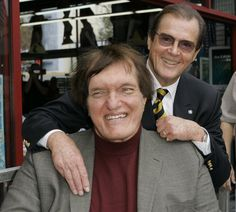 Richard Kiel (front) and Roger Moore at a ceremony in 2007 to honor Moore with a star on the Hollywood Walk of Fame. Kiel, who played Jaws in two Bond films opposite Moore, died Sept. 10, 2014. He was 74.