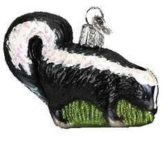 Skunk Christmas Ornament 12299, Introduced 2009 from Merck Family's Old World Christmas Adorable black and white skunk ornament made of mouth blown glass and hand painted.
