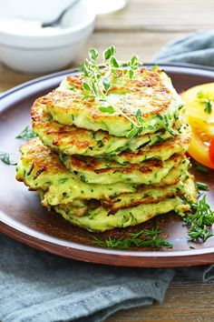 Zucchini and Parmesan Pancakes Recipe with Parmesan cheese, green onion, and oregano.