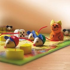 Voted Childrens Game of the Year! Viva Topo from Germany is the Ultimate in Cat and Mouse Games. Race around the board, Dodge the cat and be the player who gets home with the cheese.