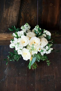 white bouquet with greenery - photo by Kristina Curtis Photography http://ruffledblog.com/diy-vine-wall-backdrop #weddingbouquet #flowers #bouquets