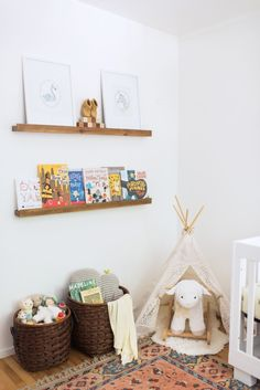 Add floating shelves to save space in your nursery: http://www.stylemepretty.com/living/2016/09/12/small-nursery-got-you-down-try-these-space-saving-tips/ Photography: Sarah Box - http://www.sarahboxphotography.com/