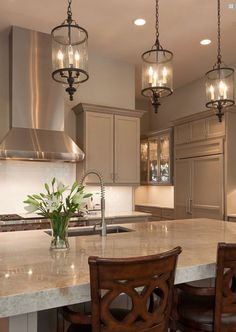 Love counters and cabinet color. Rich and different